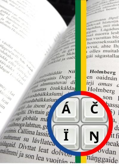 Kuvassa avattu kirja, jossa korostettu saamen kielen aakkosia